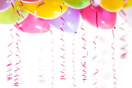 balloons with streamers for birthday party celebration isolated on white background photo