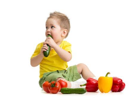 kid eating healthy food and looking aside