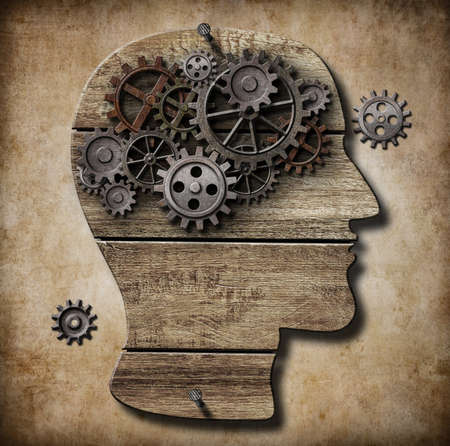 Human brain work metaphor made of rusty metal gears photo