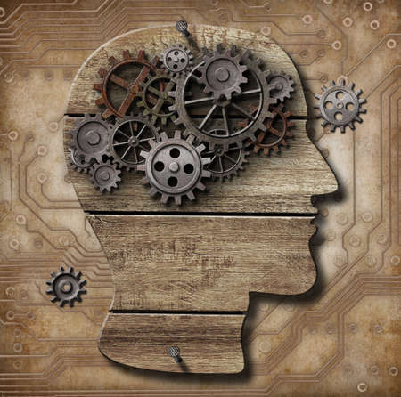 mental work: Human brain made of rusty metal gears and hogs over grunge circuit plate Stock Photo