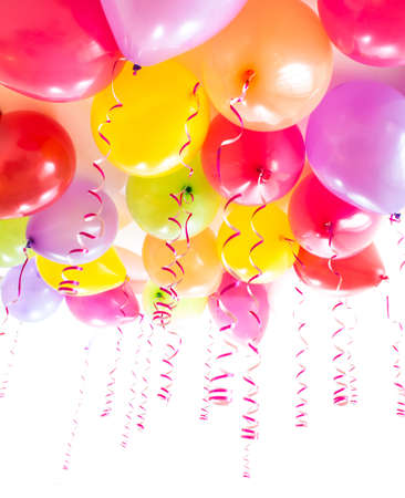 balloons party: balloons with streamers for birthday party celebration isolated on white