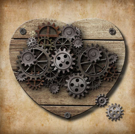 functions: Aged human heart model made of rusty metal gears Stock Photo