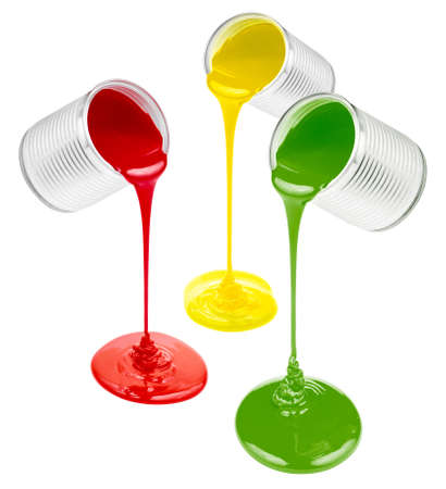 pouring colorful paints isolated on white photo