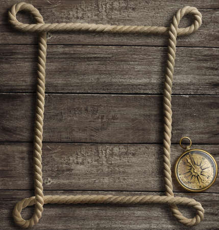 aged rope frame and old brass compass photo