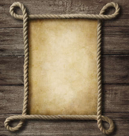 boarded: aged paper with rope frame on old wood background