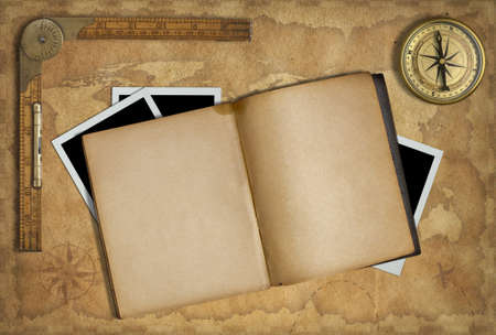 old diary: Open diary over old treasure map with compass