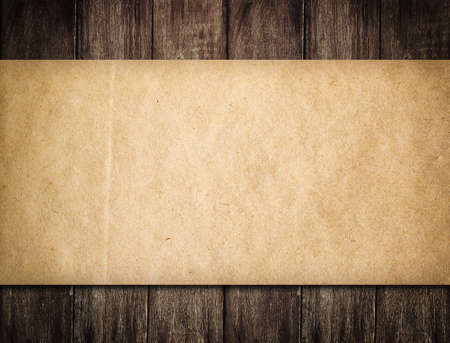 burnt wood: Grunge paper on wooden background Stock Photo