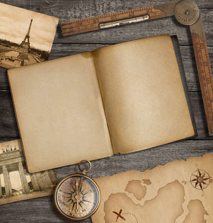 Open diary top view with old treasure map and compass photo