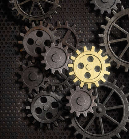 rusty gears and cogs with gold one Stock Photo - 18537217