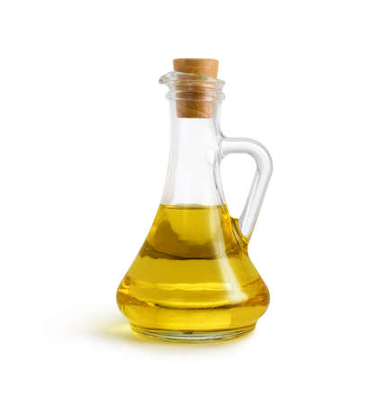 olive vegetable oil in glass pitcher isolated on white with clipping path included Stock Photo