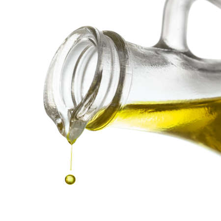 pouring: Olive oil drop close up