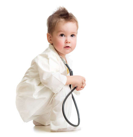 kid or child playing doctor with stethoscope isolated photo
