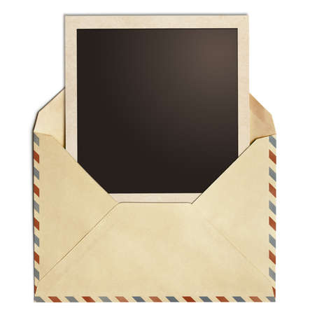 old air post envelope with polaroid photo frame isolated on white photo