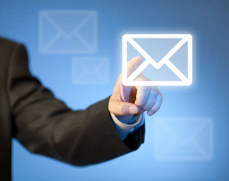 Hand pressing virtual mail button Stock Photo - 19220850