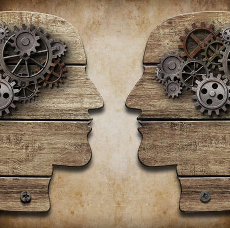 brain work: Two human head silhouettes with cogs and gears