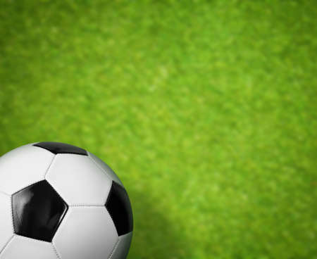 green grass soccer field and ball background photo