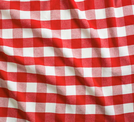 picnic blanket: red and white linen tablecloth Stock Photo