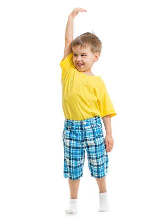 height: Kid demonstrating growing. Isolated on white studio shot. Stock Photo