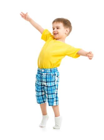 tiptoe: Funny kid boy with open arms isolated on white studio shot. Stock Photo