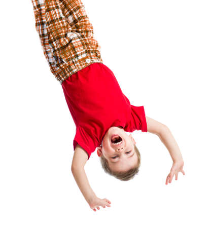 topsyturvy: kid boy upside down isolated on white Stock Photo