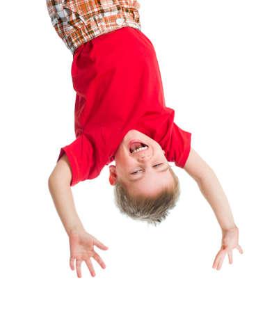topsyturvy: kid boy upside down isolated on white Stock Photo
