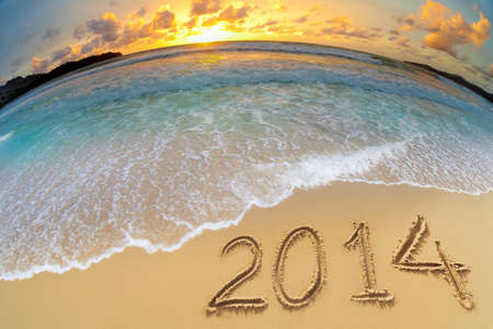 new year 2014 digits on ocean beach sand photo