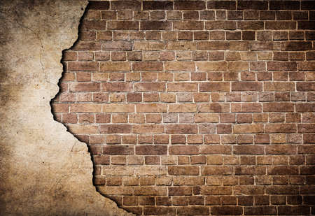 broken brick: old brick wall partially damaged Stock Photo