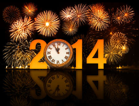displaying: 2014 year with fireworks and clock displaying 5 minutes before midnight
