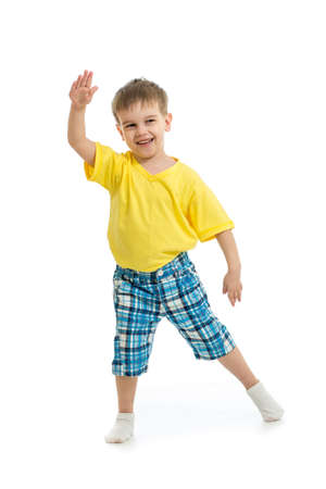 tiptoe: Funny kid boy dancing  isolated on white Stock Photo