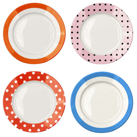 plate setting: Set of color plates with polka dot pattern isolated on white