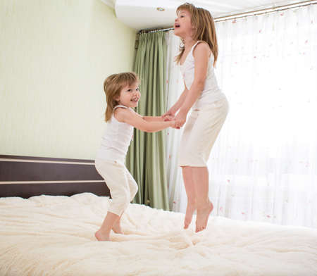 kids jumping on bed photo