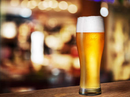 beer drinking: cold beer glass on bar or pub desk