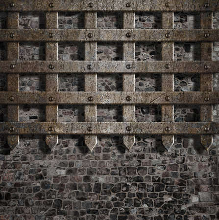 grille: medieval old metal lattice on stone wall Stock Photo