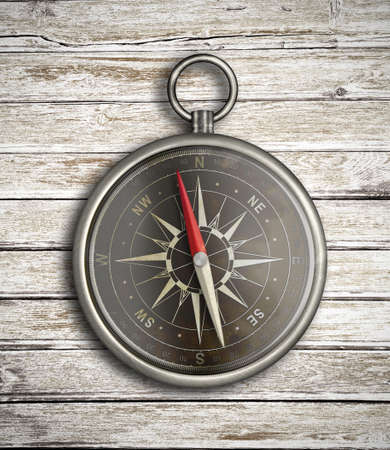 Vintage compass over wood background photo