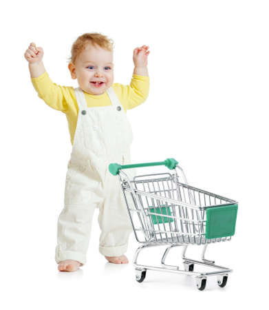 happy baby walking with shopping cart photo