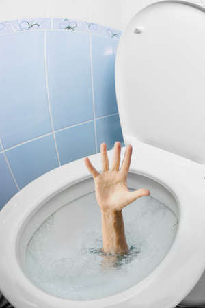 toilet bowl: Mans hand in toilet bowl or WC flushing and asking for help