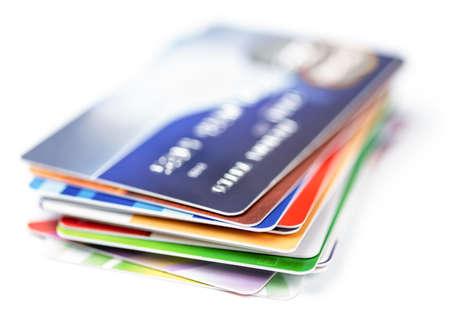 Cartes de crédit s'empilent sur blanc Banque d'images - 20919603