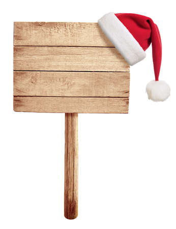 wooden road sign with red Santas hat hanging isolated on white photo