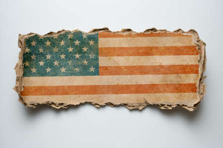 USA flag on torn cardboard photo