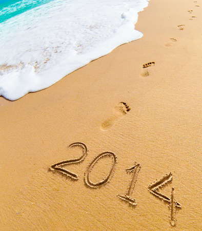 2014 and footprints on sand beach Stock Photo - 20919659