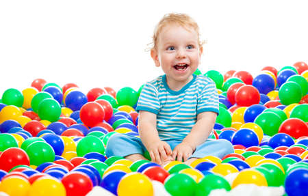 Happy kid playing colorful balls photo