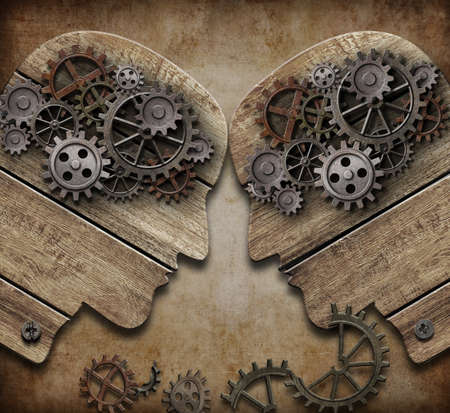 two wooden heads with gears coming into collision concept Stock Photo - 21026155