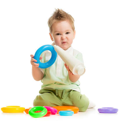 baby playing colorful toys isolated on white photo