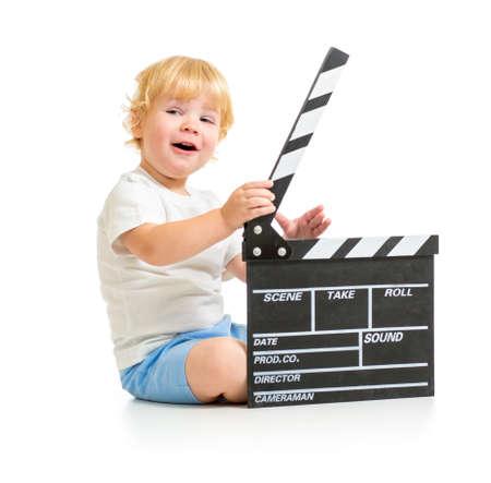 clapper board: Happy baby boy with clapper board sitting on floor