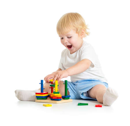 logical: Kid playing logical education toys with great interest