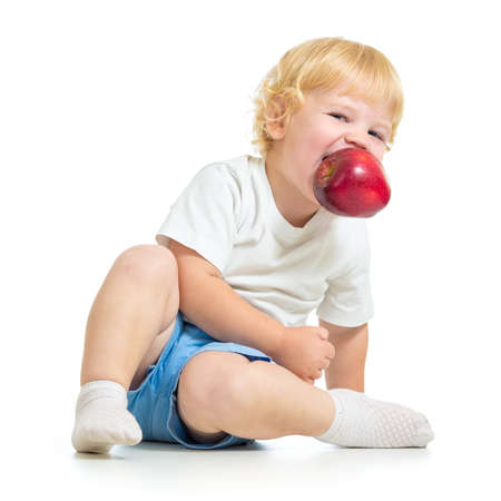 kid holding apple in mouth Stock Photo - 22217248