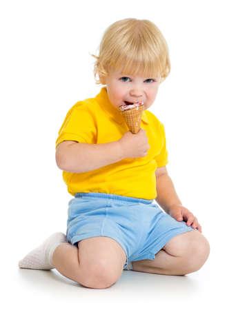 Kid boy eating ice cream isolated on white Stock Photo - 22217259