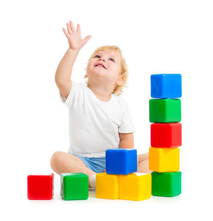 kid playing with colorful building blocks and looking up Stock Photo - 22217260