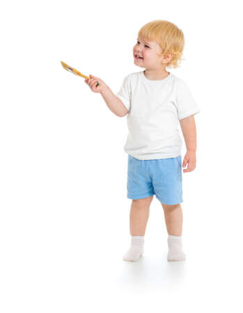 kidding: Baby boy with paint brush front view standing full length isolated on white background