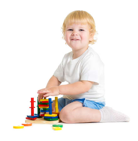 logical: Happy child playing logical educational toys